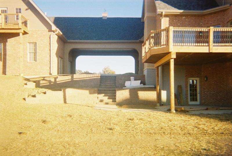 two tier retaining wall with stone steps earthworks midwest block