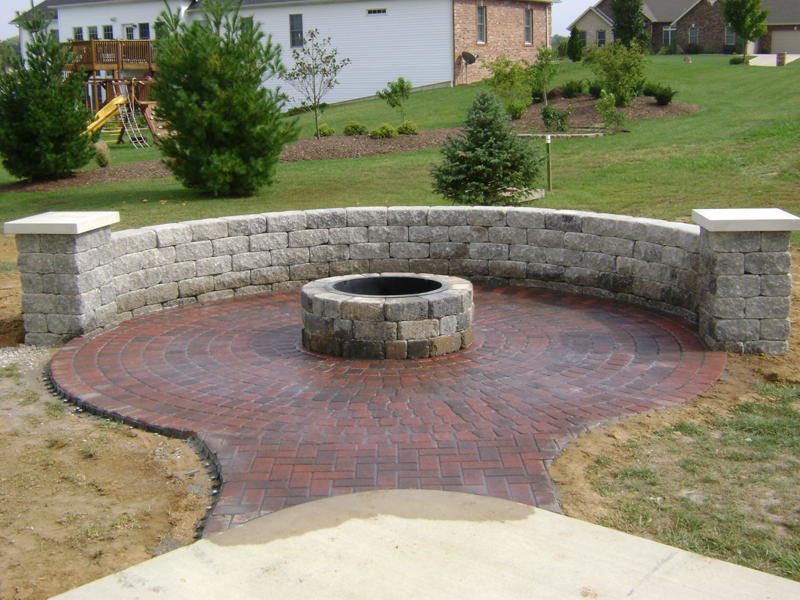 Circle Patio with fire pit and free standing wall with columns and pier caps