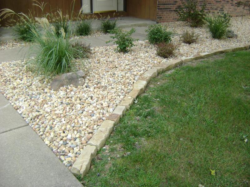 Flower bed border beautiful modern home for Decorative stone garden border